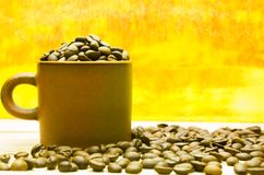 Coffee beans and cup on the wooden table.  Stock Photo