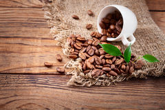 Coffee beans in cup on  wooden table. Stock Photos