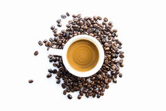 Coffee Beans. Coffee cup with coffee beans on a wooden tray Stock Photos
