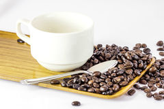 Coffee Beans. Coffee cup with coffee beans on a wooden tray Stock Photo