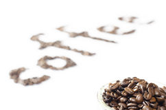 Coffee beans in the cup. And word from beans Royalty Free Stock Image