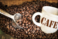 Coffee beans and cup Stock Photography