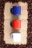 Coffee beans and cups royalty free stock images