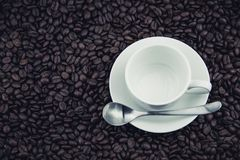 Coffee beans and coffee cups, plates Royalty Free Stock Image