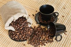 Coffee beans with cups and sack Stock Photography