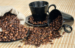 Coffee beans with cups and sack Royalty Free Stock Photo