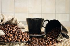 Coffee beans with cups and sack Stock Photo