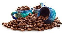 Coffee beans and cups on a white background Stock Photo