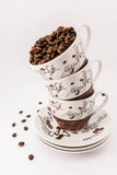 Coffee beans and cups Stock Photography