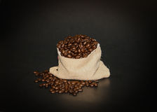 Coffee beans in dark background Royalty Free Stock Photos