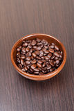 Coffee beans on a dark background. Close-up, vertical Stock Photography