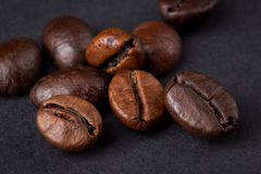 Coffee beans on a dark background. Macro Royalty Free Stock Images