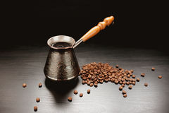 Coffee Beans On Dark Background. Coffee Pot And Coffee Beans On Dark Background Royalty Free Stock Image