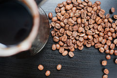 Coffee Beans On Dark Background. Coffee Pot And Coffee Beans On Dark Background Stock Image