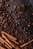 Coffee beans and dark chocolate . Background with chocolate. Coffee beans. Cinnamon sticks and star anise. Stock Images
