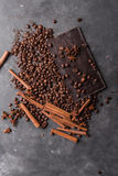 Coffee beans and dark chocolate . Background with chocolate. Coffee beans. Cinnamon sticks and star anise. Royalty Free Stock Photo