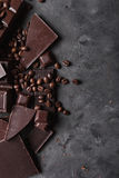 Coffee beans and dark chocolate. Chocolate bar . Background with chocolate. Coffee beans. Cinnamon sticks and star anise Stock Photography