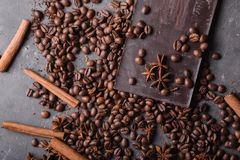 Coffee beans and dark chocolate. Chocolate bar . Background with chocolate. Coffee beans. Cinnamon sticks and star anise Stock Photos