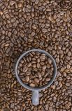 Coffee beans in dark cup on mixed coffee beans background stock photos