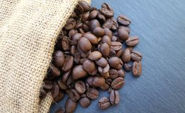 Coffee beans on dark stone background Royalty Free Stock Image