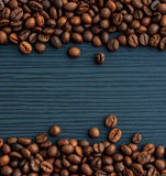 Coffee beans on dark wood Royalty Free Stock Images