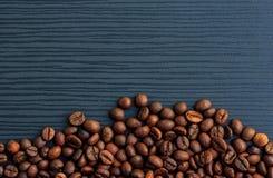 Coffee beans on dark wood Royalty Free Stock Photos