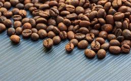 Coffee beans on dark wood Royalty Free Stock Image