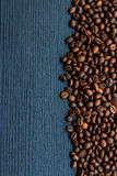 Coffee beans on dark wood Stock Images