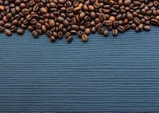 Coffee beans on dark wood Stock Photos
