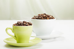 Coffee beans in different cups closeup Stock Image