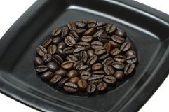 Coffee beans on dish Royalty Free Stock Images