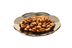 Coffee beans on a dish on a white background Royalty Free Stock Images