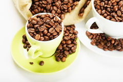 Coffee beans in dishware closeup Royalty Free Stock Images
