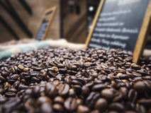 Coffee beans display with sign black board in market retail store. Roasted Coffee beans display with sign black board in market retail store royalty free stock image