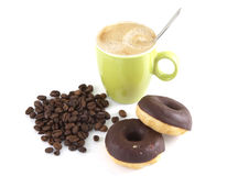 Coffee with beans and donuts Stock Image