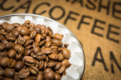 Coffee beans in the dripper and a linen bag for coffee Royalty Free Stock Photography