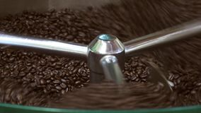 Coffee beans drying after toast process, loopable stock video footage