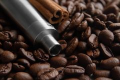 Coffee and cinnamon flavored vape juice concept royalty free stock images