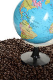 Coffee beans and earth model Stock Image