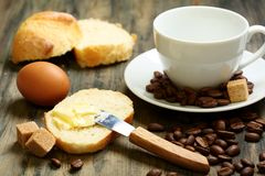 Coffee beans, eggs, bread and butter. Stock Image