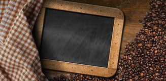 Coffee Beans with Empty Blackboard Royalty Free Stock Image