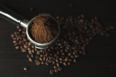Coffee beans and ground powder. Coffee beans Espresso Coffee Coffee beans and ground powder Preparing coffee close up Brown coffee beans splash stock image