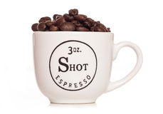 Coffee beans in a espresso cup Royalty Free Stock Photos