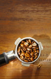Coffee beans in an espresso filter Royalty Free Stock Image
