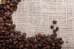 Coffee beans on fabric Royalty Free Stock Photos