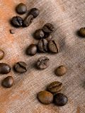 Coffee beans on fabric background Royalty Free Stock Photos