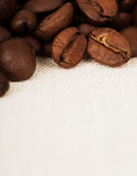 Coffee beans on fabric background Stock Photography