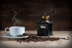 Coffee beans. On fabric tablecloth with aged wood background stock photo