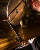 Coffee beans falling from antique dispenser machine from 1900 stock photos