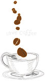 Coffee beans falling in cup Stock Image